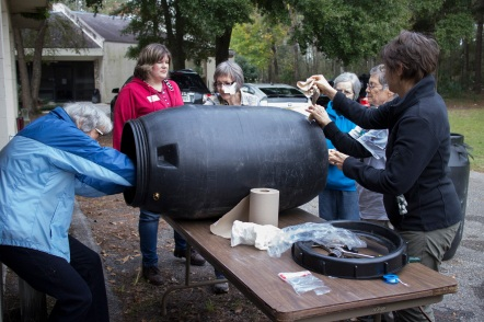 People work at a rain barrel building workshop at the Alachua County Extension Office. Photo taken December 4th, 2015.